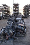 Used motors and spares. Used motors in the floor, spare parts in racks in the background Royalty Free Stock Photos