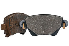Used and new brake pad. Used brake pad compared with the new one Stock Image