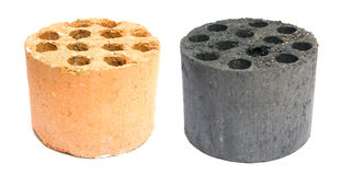 Used and new coal briquette Royalty Free Stock Image