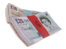 Used Notes. Wrapped bundles of used £10 and £20 notes Stock Images