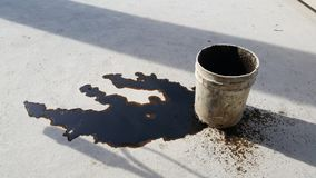 Used oil spill is on the floor. Wait for cleaning royalty free stock images