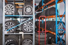 Used old car tires at warehouse stock images