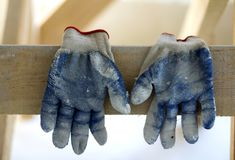 Used old dirty torn worker& x27;s gloves as a metaphor, concept or sy Stock Images