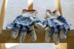 Used old dirty torn worker& x27;s gloves as a metaphor, concept or sy Royalty Free Stock Photo