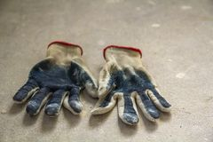 Used old dirty torn worker& x27;s gloves as a metaphor, concept or sy. Mbol for the end of the work season Stock Images