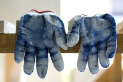 Used old dirty torn worker& x27;s gloves as a metaphor, concept or sy Royalty Free Stock Images