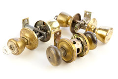 Used old door locks & knobs. Used, old and weathered door locks & knobs for recycling and reuse on white Royalty Free Stock Photography