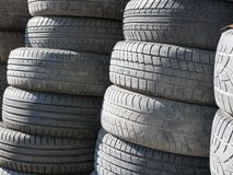 Used, old tires stacked one on another next to shop garage stock photos
