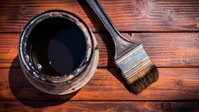 Used paint brush next to a paint can, view from above Stock Photography