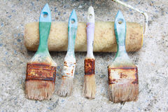 Used paint brushes. With size 63mm.2-1/2 in  25 mm(1 in) 19mm.(3/4 in) and Paint Roller Royalty Free Stock Image