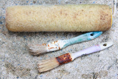 Used paint brushes. With size  25 mm1 in  19mm.(3/4 in) and Paint Roller Royalty Free Stock Photography
