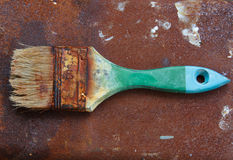 Used paint brushes. With size 63mm.2-1/2 in on the rust Royalty Free Stock Images