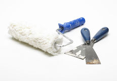 Used paint roller and spatula Royalty Free Stock Photos