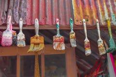 Used Paintbrushes Hanging Stock Photography