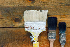 Used paintbrushes on old wooden table Royalty Free Stock Image