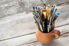 Used painter paintbrushes in a jug Stock Photography