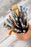 Used painter paintbrushes in a jug from potters clay Stock Photography