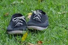 Used pair of tennis shoes royalty free stock photography