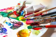 Used palette of the artist with mixed colors of acrylic paints c stock photography