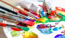 Used palette of the artist with mixed colors of acrylic paints c stock photos