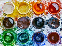 Used palette of children`s watercolor paint Stock Images