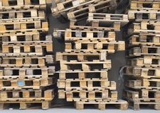 Used pallets in the warehouse royalty free stock photo