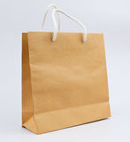 Used paper bag white rope on gray background Stock Photos