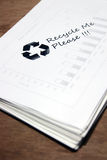 Used paper with recycle sign Stock Images