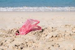 Used plastic bag on sand beach. Pollution of the beach royalty free stock photos