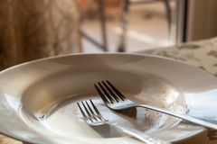 Used plate with forks royalty free stock photos
