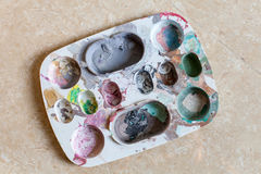 Used Plate painted many colors stock photography