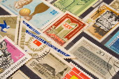 Used postage stamps. Collection of postage stamps from a variety of countries Stock Image