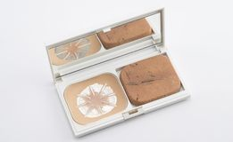 Used pressed powder. On white background Royalty Free Stock Images