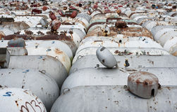 Used propane tanks. A large storage facility full of old corroded propane tanks stock images