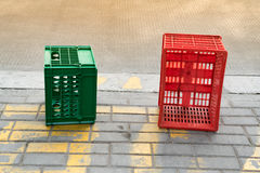 Used red and green plastic box beside the road Royalty Free Stock Photo