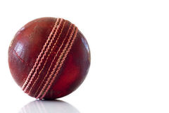 Used red leather cricket ball. Old red leather cricket ball isolated against a white background royalty free stock photography