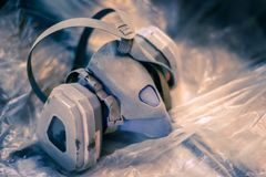 The used respirator lies on the cellophane royalty free stock photos