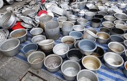 Used rice cooker inner pots on sales in flea market Royalty Free Stock Images