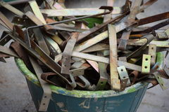 Used roof hooks in bucket. For reuse or recycle stock images