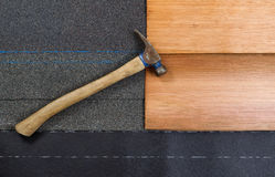 Used roofing hammer with new shingles of composite and cedar woo Royalty Free Stock Photography