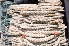Used ropes at ship chandler. Coils of used ropes at ship chandler in Myeik, Myanmar. Shallow depth of field Royalty Free Stock Photos