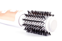 Used rotating hair brush isolated on white. Used electric rotating hair brush isolated on white background royalty free stock image