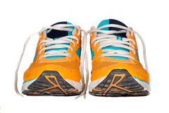 Used running shoes orange Royalty Free Stock Photo