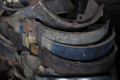 Used rusty metallic car parts in garage. Stack of used rusty metallic car parts in garage Royalty Free Stock Image