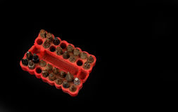 Used screwdriver bits in a red rubber organizer Stock Photo