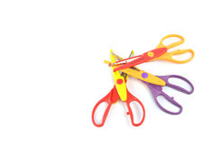 Used serrated color scissors isolated on white background Stock Photo