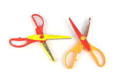 Used serrated color scissors on white background Royalty Free Stock Photo