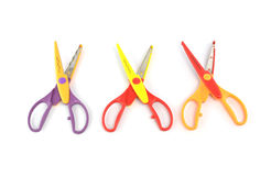 Used serrated color scissors on white background Royalty Free Stock Images