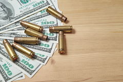 The used shell casings is on a money. Background Royalty Free Stock Photo