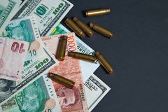 The used shell casings is on a money Stock Images